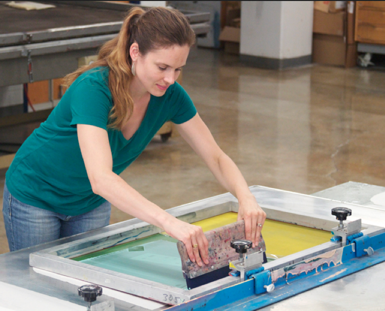 This is me screenprinting in the printshop at Indiana University.