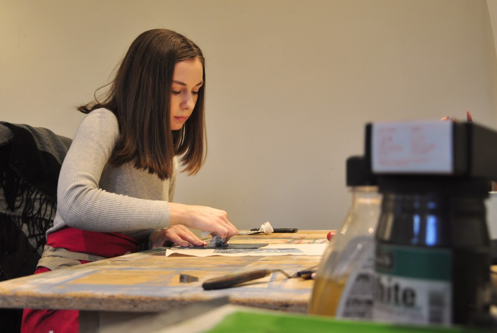 Amber Roach working in her studio at Main Street Arts