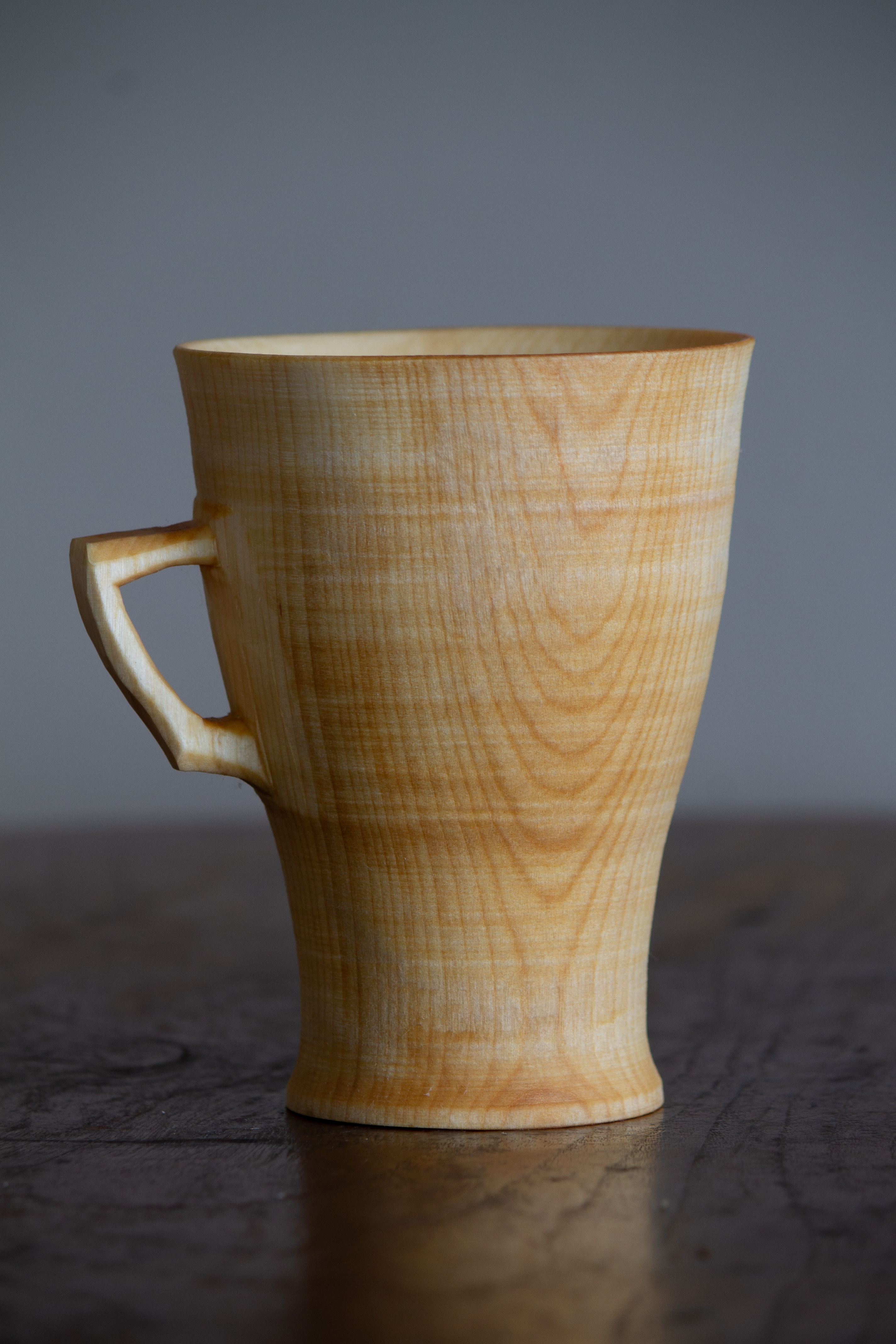 Lámhóg is a traditional Irish drinking cup turned from one piece of wood on a reciprocating foot powered pole lathe.