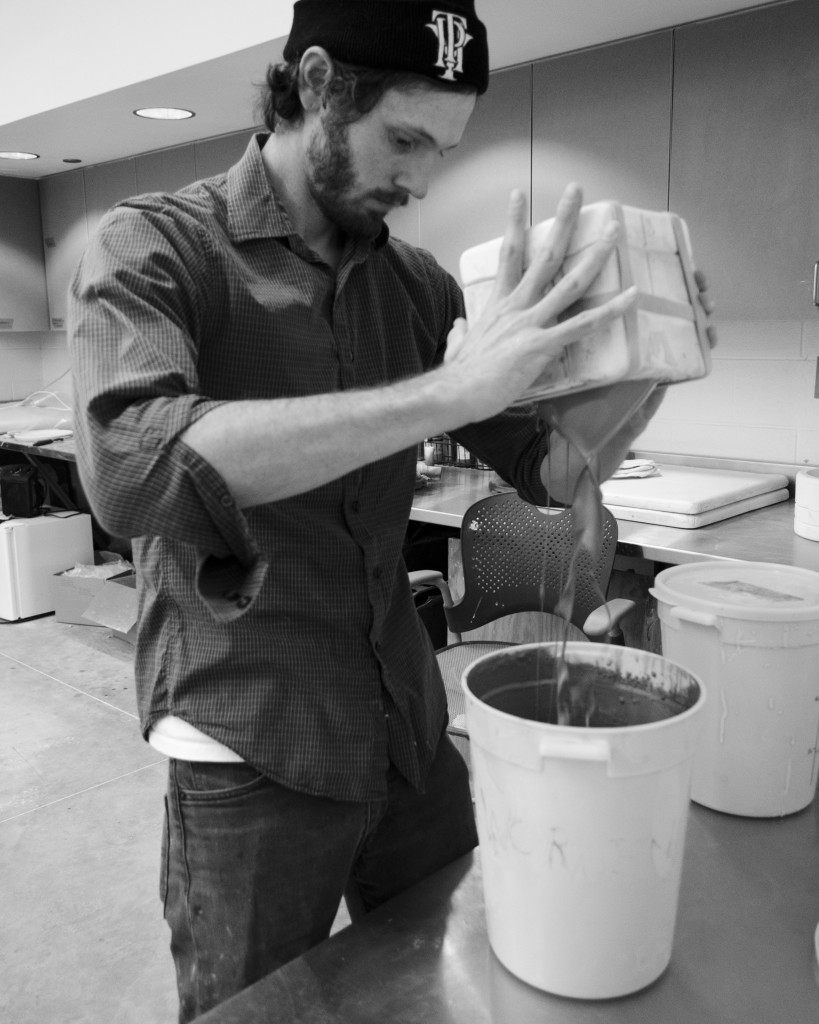 Cole Worden pouring slip from a mold