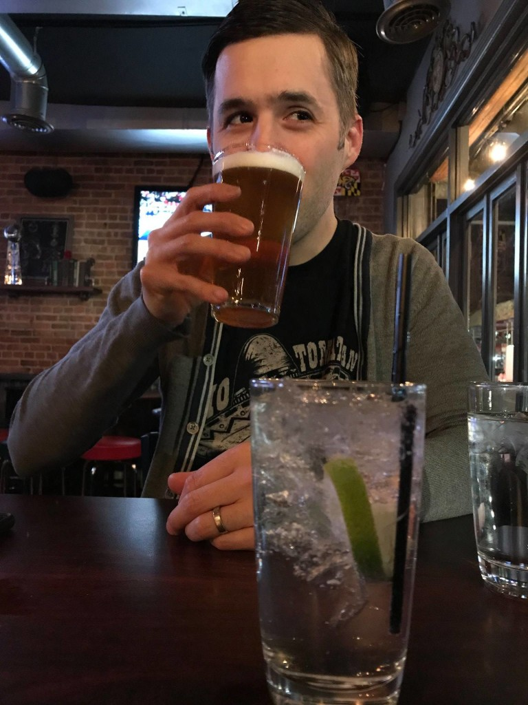 Bradley Butler, executive director and curator, drinking a beer in New York City