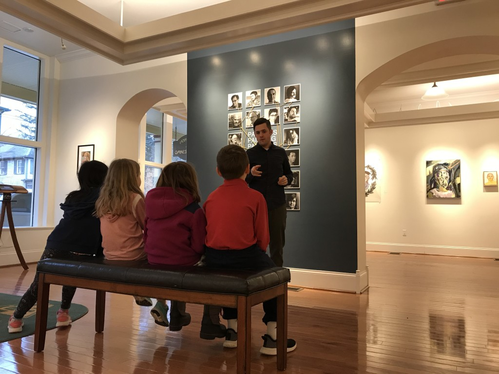 Explaining the exhibition to students in our After School Art Experience program