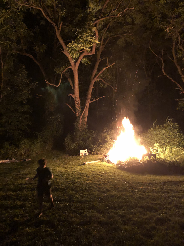 A scene from bonfire at Sarah's sister's house at the end of summer last year. Nephew running away from fire for scale.