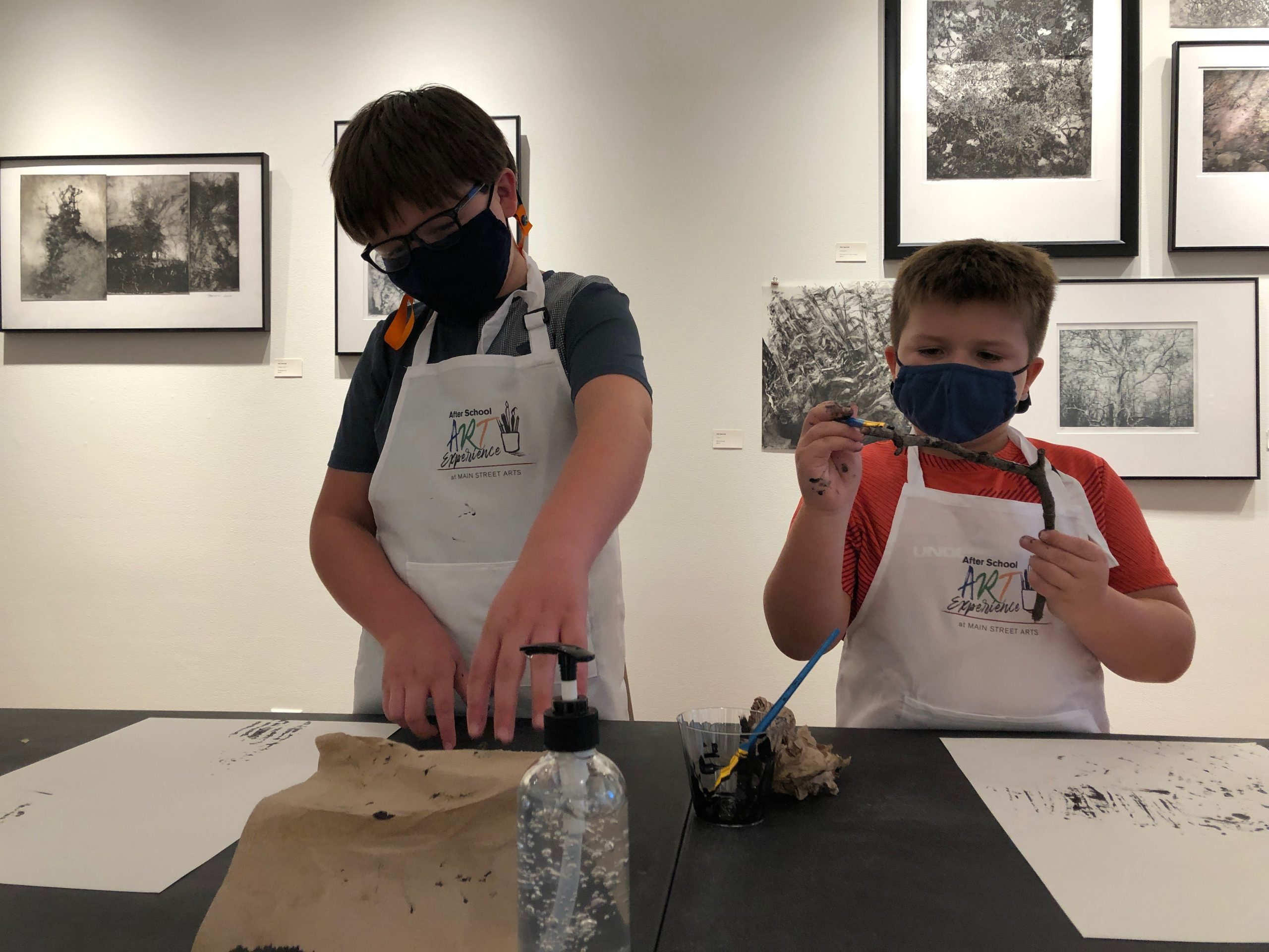 Two students making art in the gallery at Main Street Arts