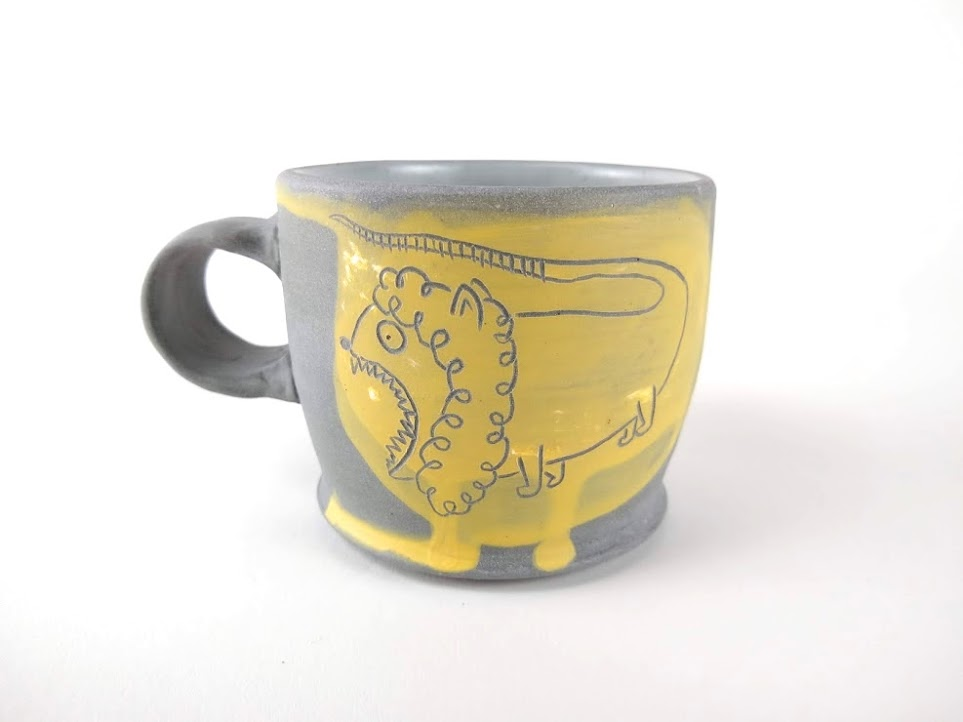 Untitled (Yellow Lion Mug) by Mark Vander Heide—included in The Cup, The Mug 2019