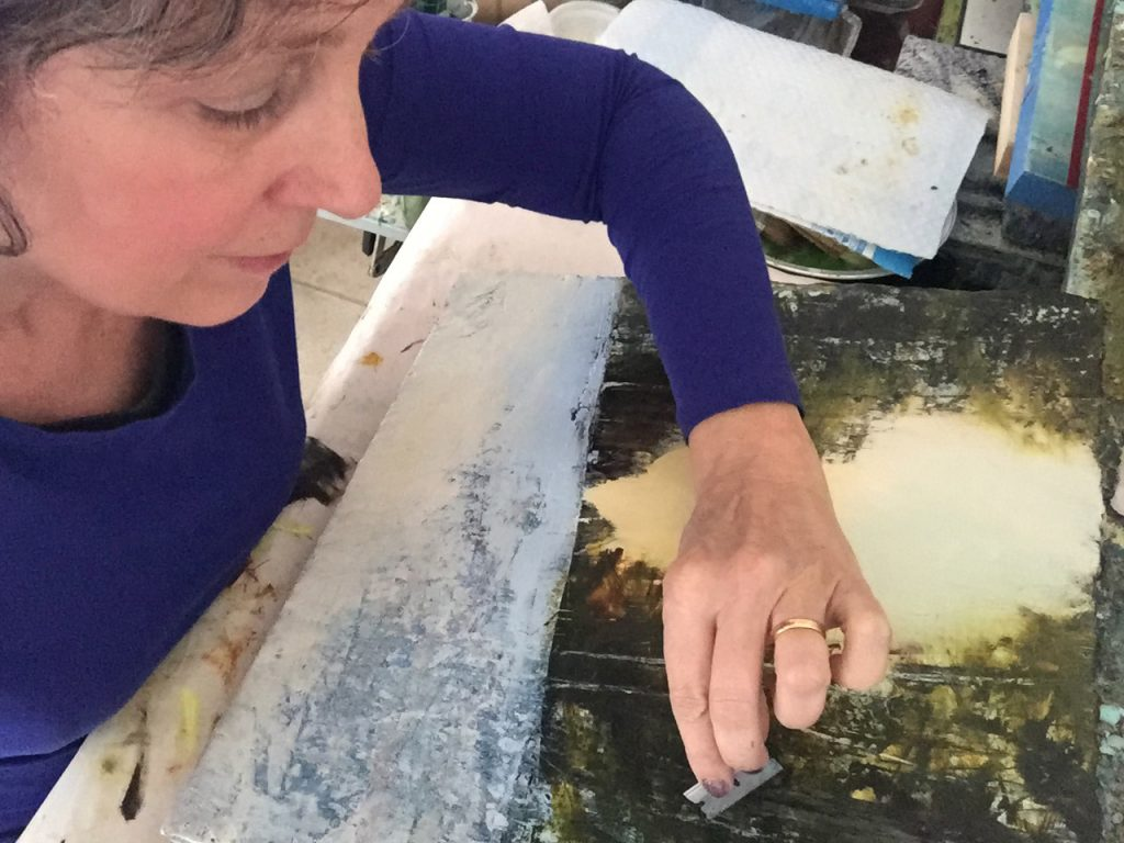 Regina Quinn working on an encaustic painting