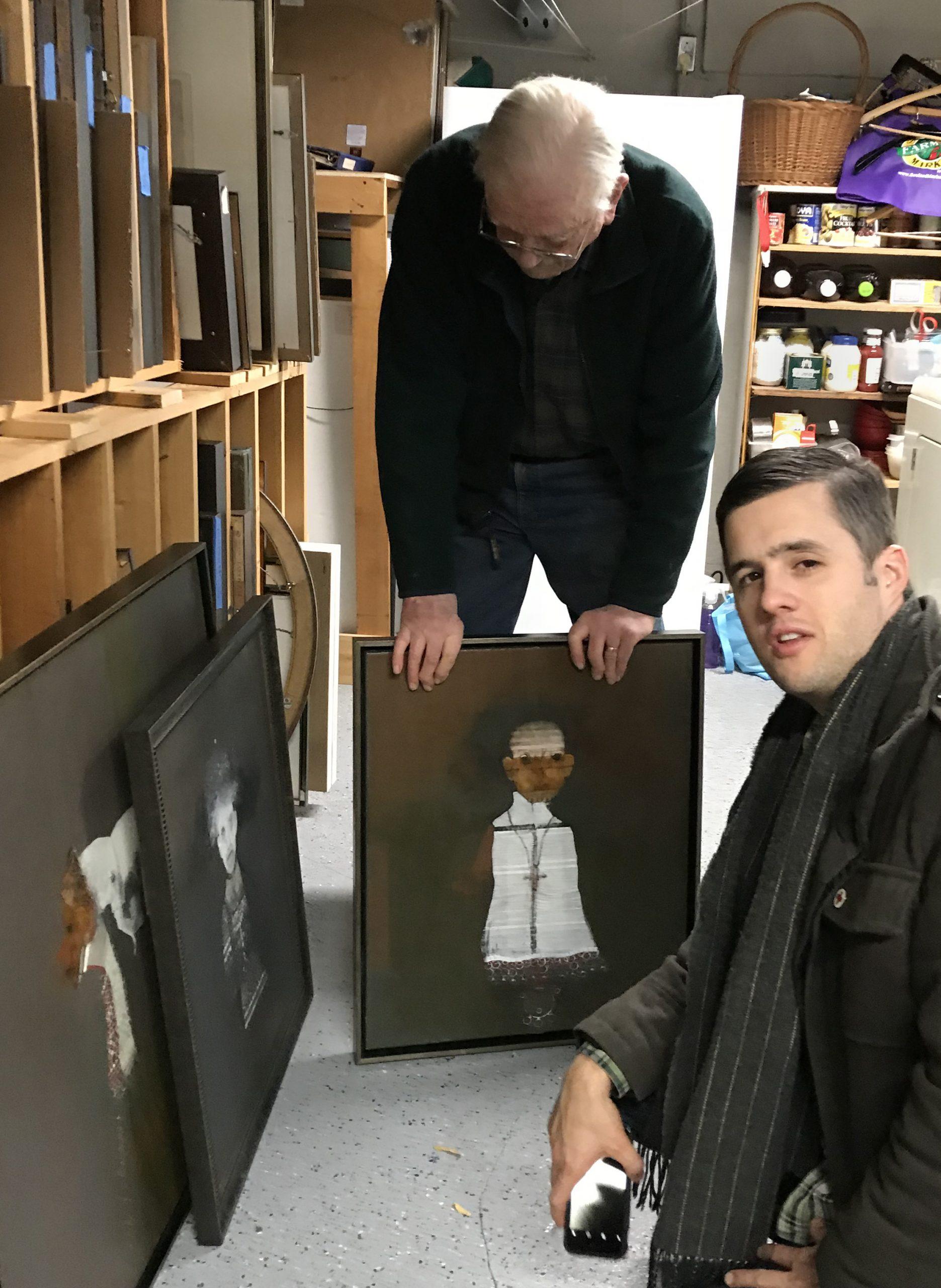 Artist and curator in artist studio