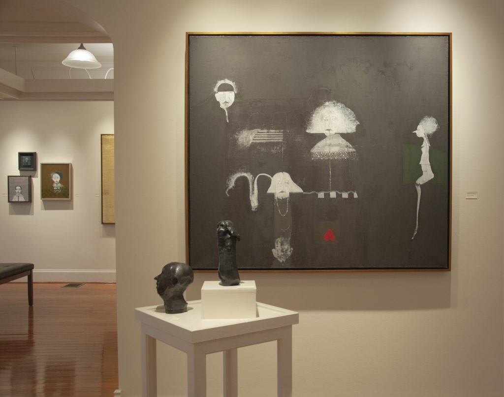 paintings and sculpture in an art gallery