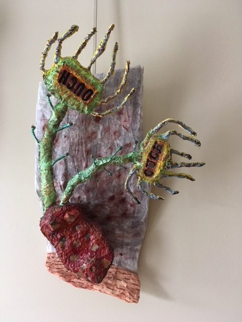 "Susan Mandl's mixed media artwork ""Ouch"" in the Diner's Club exhibition"