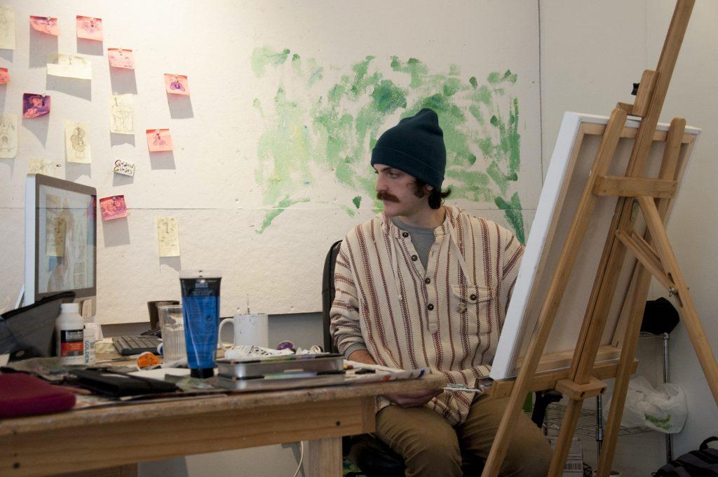 Artist working in painting studio